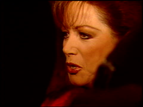 jackie collins at the premiere of 'the russia house' at universal in universal city, california on december 4, 1990. - ユニバーサルシティ点の映像素材/bロール