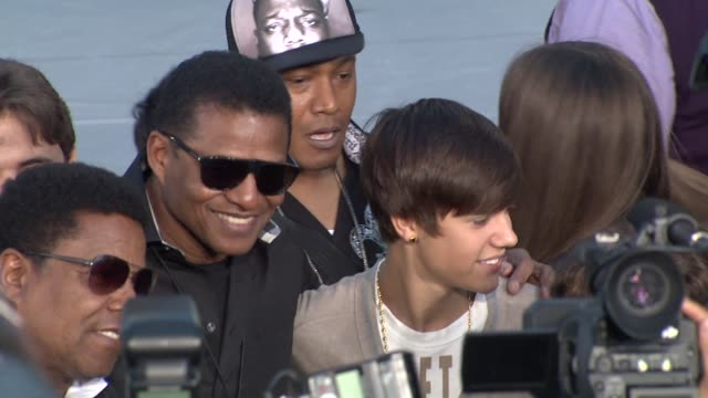 jackie jackson tito jackson and justin bieber at michael jackson immortalized with hand and footprint ceremony in hollywood ca on 1/26/2012 - michael jackson stock videos and b-roll footage