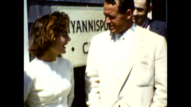 """jackie kennedy and man in white suit standing in front of sign """"hyannisport club"""", smiling at the camera - jackie kennedy stock videos & royalty-free footage"""