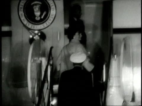 jackie kennedy climbing stairs to board air force one with jfk on an important international trip / washington dc united states - jackie kennedy stock-videos und b-roll-filmmaterial