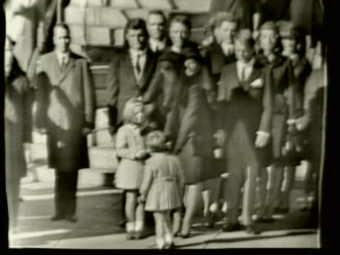 jackie kennedy takes a book from jfk jr.; then he salutes his father's coffin during the state funeral of president john f. kennedy. - jackie kennedy stock videos & royalty-free footage