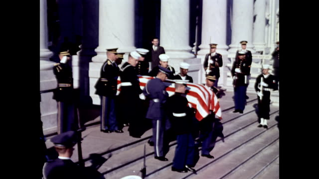 / jackie kennedy walking down steps escorted by robert and edward kennedy / mrs kennedy precedes her husband's coffin as it leaves the capitol... - attentat auf john f. kennedy stock-videos und b-roll-filmmaterial