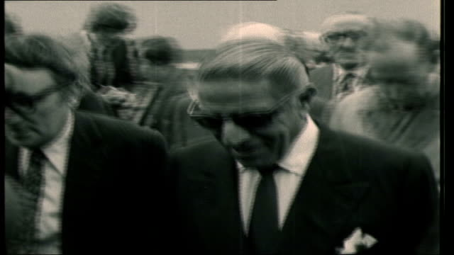 jackie onassis and aristotle onassis visit harland and wolff shipyard aristotle onassis towards with others car away sign reading 'harland wolff... - jackie kennedy stock-videos und b-roll-filmmaterial
