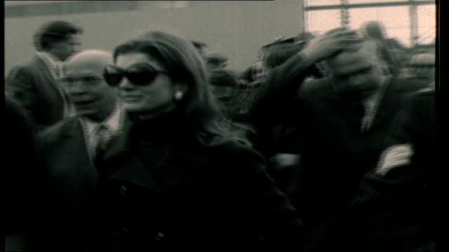 jackie onassis and aristotle onassis visit harland and wolff shipyard jackie onassis along surrounded by photographers people along jackie onassis... - jackie kennedy stock-videos und b-roll-filmmaterial