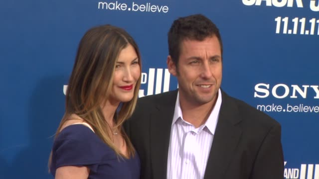 jackie sandler and adam sandler at the 'jack and jill' world premiere at westwood ca - ウェストウッド地区点の映像素材/bロール