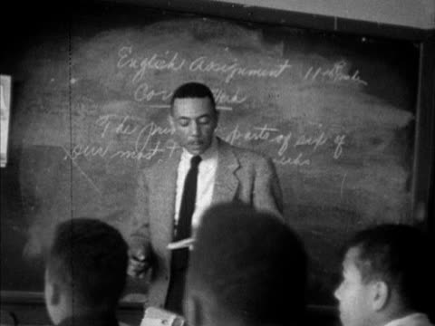 jackson high school w/ africanamerican teenagers out front male teacher thomas 'daddy mac' mclester writing english assignment on board thomas... - jim crow laws stock videos & royalty-free footage
