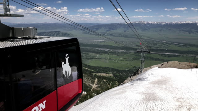 jackson hole aerial tram is located in jackson hole, wyoming and has become an iconic symbol of the town. located at jackson hole mountain resort, it... - grand teton stock videos & royalty-free footage