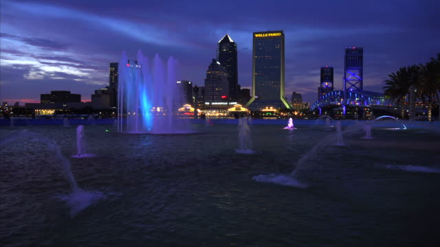 Jacksonville, Florida city skyline and water fountain at sunset