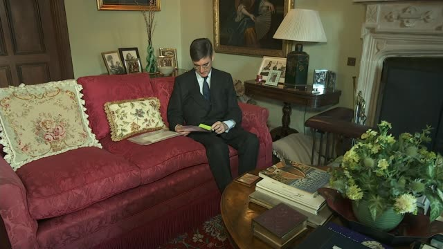 jacob reesmogg 'completely opposed to abortion' tx north east somerset setup seated on sofa reading document - somerset england stock-videos und b-roll-filmmaterial