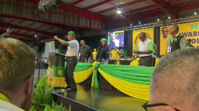 Jacob Zuma and Cyril Ramaphosa singing after Ramaphosa wins the ANC leadership election