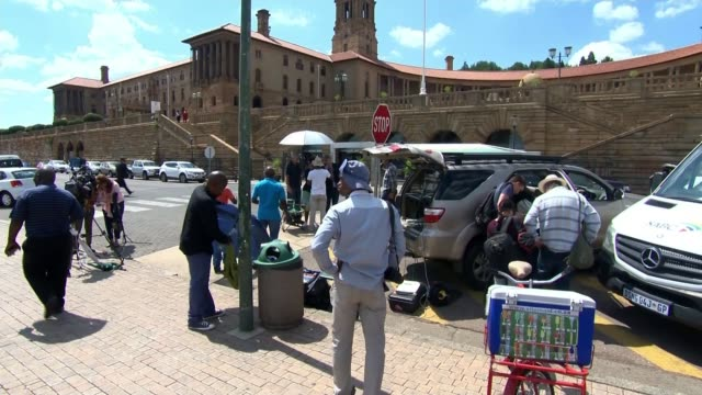 Jacob Zuma resigns as president SOUTH AFRICA Pretoria EXT Various of journalists and others gathered around parked cars parked outside parliament...