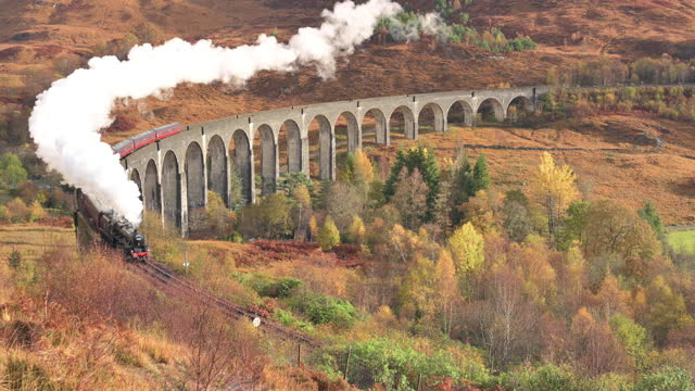 jacobite steam train passes over glenfinnan viaduct. glenfinnan, scottish highlands, scotland, uk - locomotive stock videos & royalty-free footage