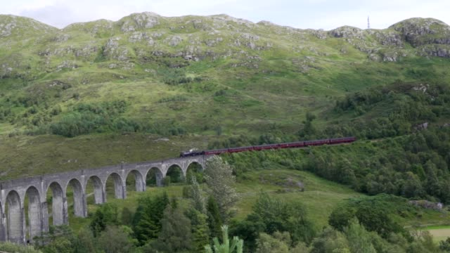 jacobite train crossing the glenfinnan viaduct in scotland - scottish highlands stock videos & royalty-free footage