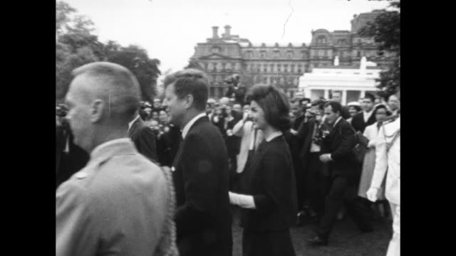 stockvideo's en b-roll-footage met jacqueline and president kennedy walk into a large group on people on the white house lawn and greet them - jacqueline kennedy