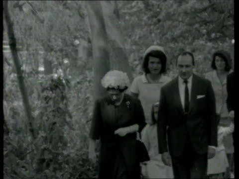 MS Jacqueline Kennedy and Prince Philip walking and holding John Kennedy Jr's hands/ Runnymede England