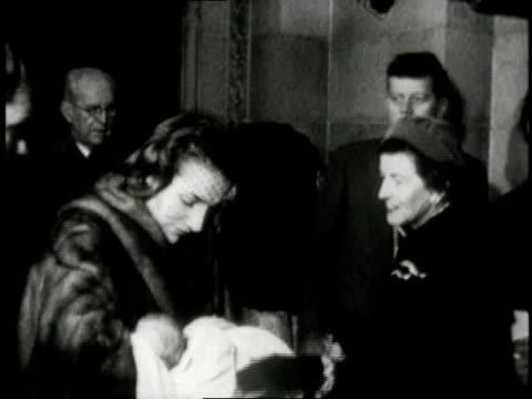 Jacqueline Kennedy holding baby Caroline Kennedy / United States