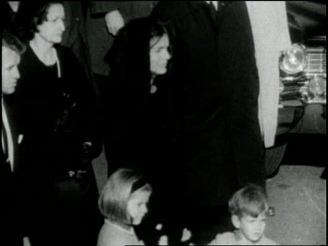stockvideo's en b-roll-footage met jacqueline kennedy holds her children's hands during the funeral of her husband us president john f kennedy - jacqueline kennedy