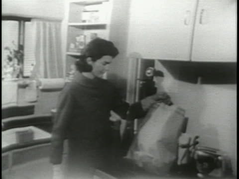 jacqueline kennedy in 1957 as she walks her dog, runs errands, and relaxes at home in georgetown. - 1957 stock-videos und b-roll-filmmaterial