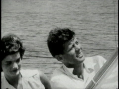 stockvideo's en b-roll-footage met jacqueline kennedy onassis and john f kennedy on a small sailboat / cape cod massachusetts united states - jacqueline kennedy