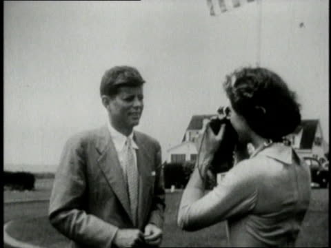 vidéos et rushes de jacqueline kennedy onassis taking a photograph of john f kennedy / cape cod massachusetts united states - 1953