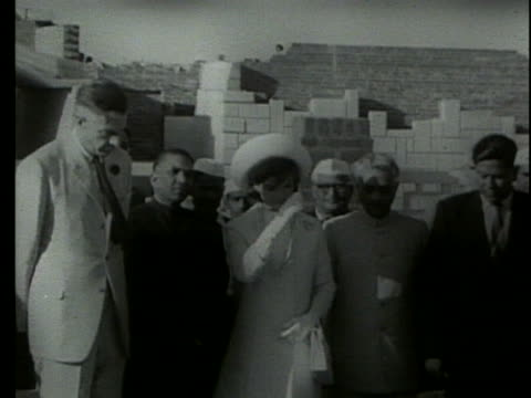 jacqueline kennedy places a wreath in india. - (war or terrorism or election or government or illness or news event or speech or politics or politician or conflict or military or extreme weather or business or economy) and not usa stock videos & royalty-free footage