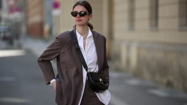 jacqueline zelwis is seen wearing brown inwear blazer and pants, zara button shirt in white, flattered loafers, furla bag and versace sunglasses on... - suit stock videos & royalty-free footage