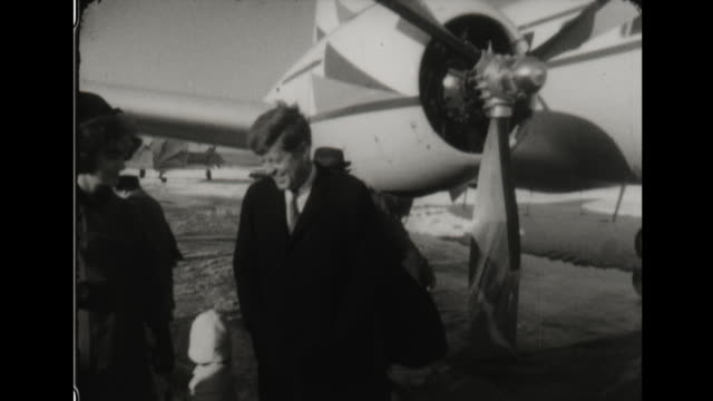jacquline kennedy walks down plane stairs with caroline kennedy. - 1960 stock videos & royalty-free footage