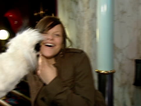 vídeos de stock, filmes e b-roll de jade goody and boyfriend jeff brazier at premier of 'jackass' film goody playing with fluffy puppet joking letting puppet kiss her cheek jade goody... - big brother