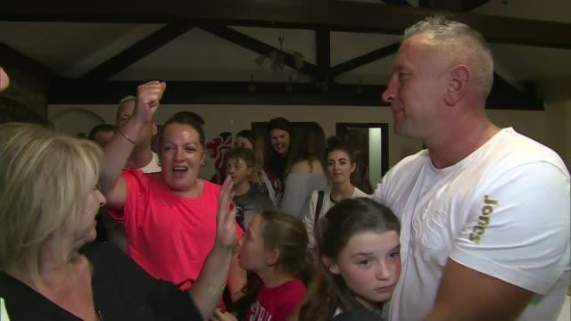 jade jones wins taekwondo / family celebrate in wales; wales: flintshire: flint: int friends and family of jade jones cheer and applaud as watching... - wales stock videos & royalty-free footage