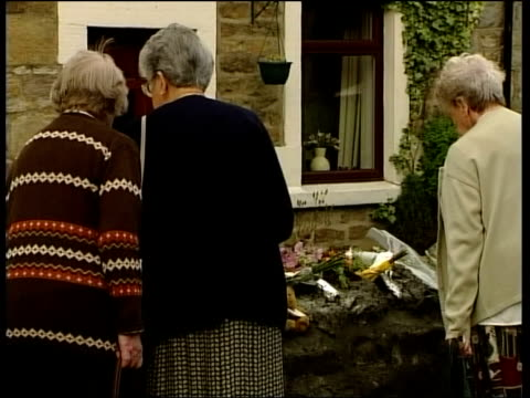 results expected itn england lancashire galgate ext group of women looking at floral tributes on wall of cottage where 10year old jade slack died of... - drug overdose stock videos and b-roll footage