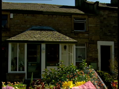 results expected itn england lancashire galgate flowers outside cottage where 10year old jade slack died of suspected drug overdose tilt up house cs... - drug overdose stock videos and b-roll footage