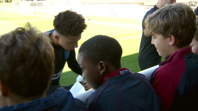 jadon sancho prepares for england debut england staffordshire buron upon trent st george's park national football centre jadon sancho signing... - autographing stock videos & royalty-free footage