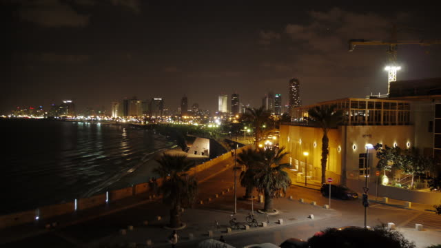 jaffa beach at night with tel aviv skyline in background - time lapse - spoonfilm stock-videos und b-roll-filmmaterial
