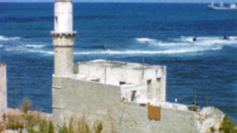 jaffa harbor and al-bahr mosque / ramat gan streets / paz gas station / elite company / jaffa views and streets on may 10, 1962 in jaffa, israel - ジャファ点の映像素材/bロール