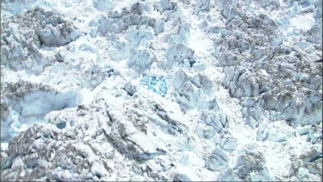 jagged cliffs and peaks mark the columbia glacier in alaska. available in hd. - columbia glacier stock videos & royalty-free footage