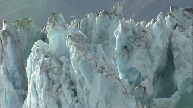 jagged cliffs mark the columbia glacier in alaska. available in hd. - columbia glacier stock videos & royalty-free footage