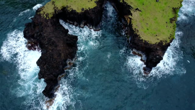 jagged coastal feature on maui island as seen by drone - steep stock videos & royalty-free footage