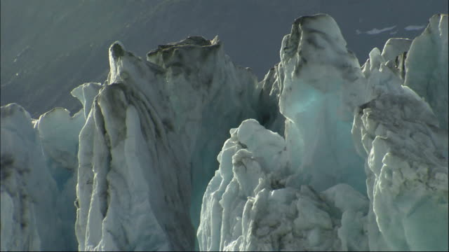 jagged cracked ice peaks mark the columbia glacier in alaska. available in hd. - columbia glacier stock videos & royalty-free footage