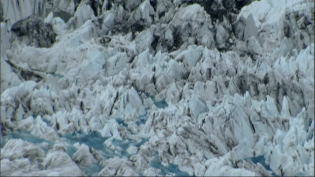 jagged ice covers the columbia glacier in alaska. available in hd. - columbia glacier stock videos & royalty-free footage