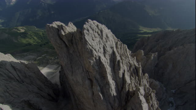 jagged peaks jut from ridges of the swiss alps. available in hd. - ravine stock videos & royalty-free footage