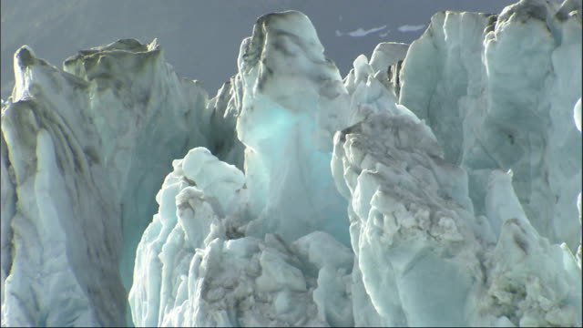 a jagged wall of ice towers at the foot of alaska's columbia glacier. available in hd. - columbia glacier stock videos & royalty-free footage