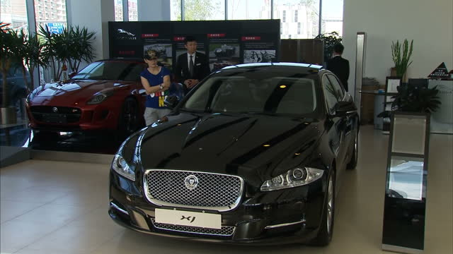 jaguar land rover showroom in beijing on september 10, 2013 in beijing, china - land rover stock videos & royalty-free footage