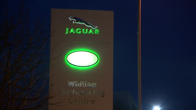 jaguar land rover whitley engineering centre sign illuminated at night, coventry - land rover stock videos & royalty-free footage