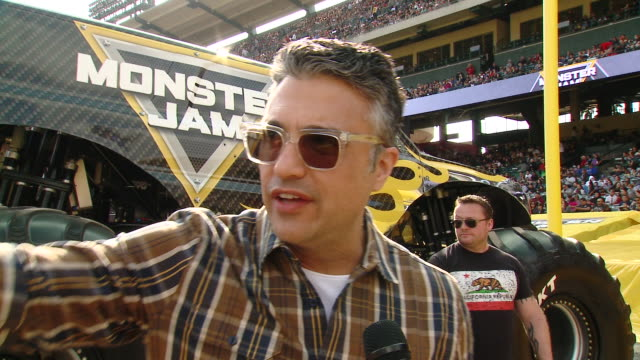 jaime camil on tell us who are you here with today and what are you looking forward to seeing at monster jam, on which truck is your favorite and... - angel stadium stock videos & royalty-free footage
