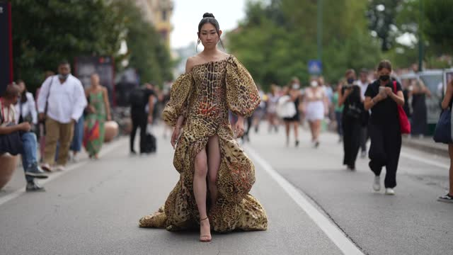 jaime xie wears a one-shoulder long party yellow/khaki and black snake pattern print dress / gown with puff sleeves, earrings, during the 78th venice... - ponytail stock videos & royalty-free footage