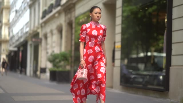 jaime xie wears a red dress with white floral print a lady dior bag during paris fashion week haute couture fall/winter 2019/2020 on july 01 2019 in... - floral pattern stock videos & royalty-free footage