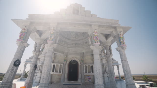 jain white temple at chennai india dolly shot - temple building stock videos & royalty-free footage