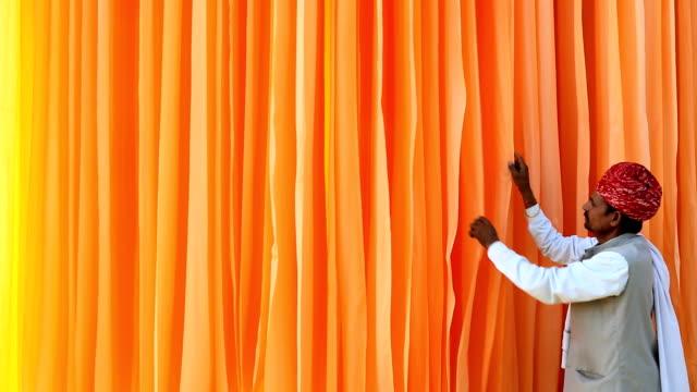 jaipur india asia sari factory male textiles dyed worker - dye stock videos & royalty-free footage