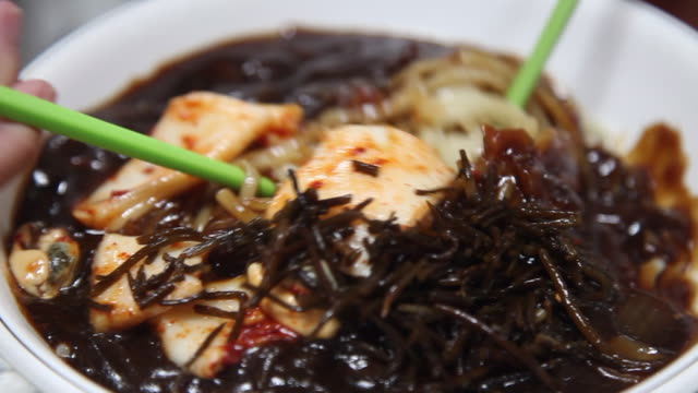 jajangmyeon (black-bean-sauce noodles) mixing in the bowl (korean food), udo island - seaweed stock videos & royalty-free footage