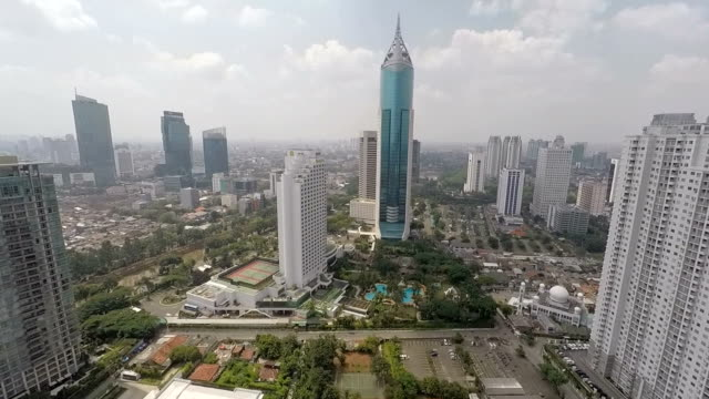 jakarta bni 46 tower away from - indonesia video stock e b–roll